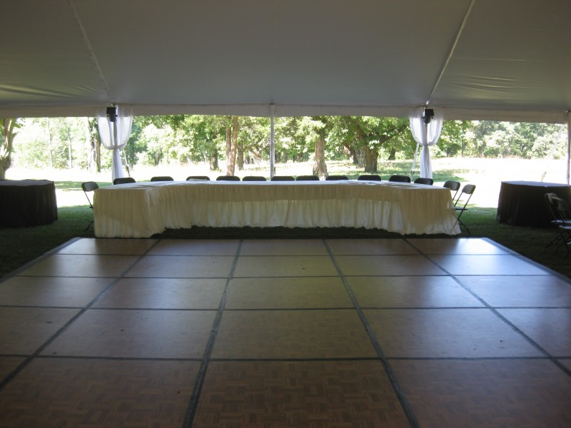 Wedding dance floor encompassed by head table.